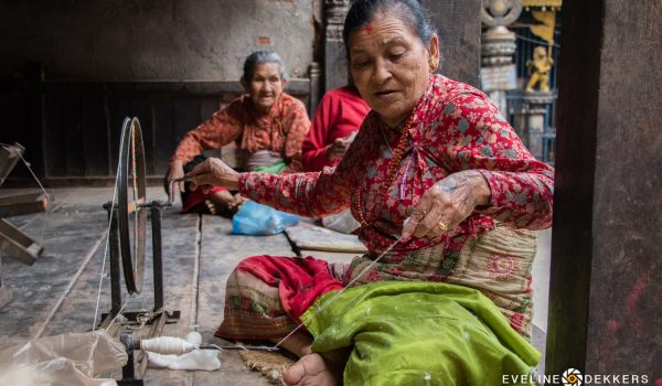 Nepalese Woman Working With An Old Spinning Wheel – Nepal