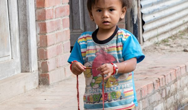 Little Kid Playing With Some Fabric – Nepal