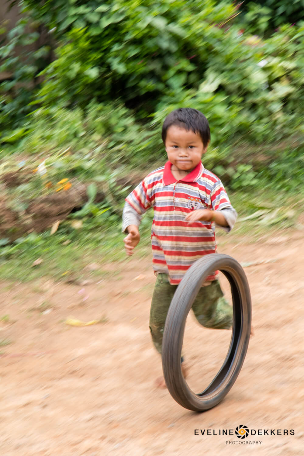 A stick and a tire is all you need for fun - Myanmar